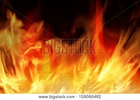 Farbic on fire with flames - Fire safety concept.