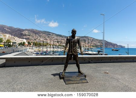 FUNCHAL, MADEIRA, SPAIN - SEPTEMBER 2, 2016: The staue Christiano Ronaldo before the entry to the Museum CR 7 in Funchal on Madeira. Portugal