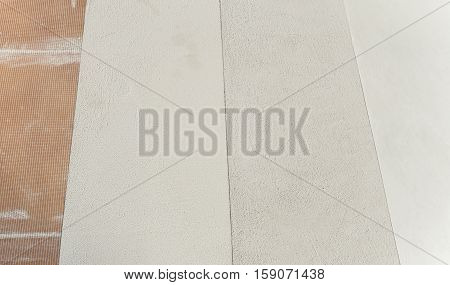 different microcement layers above stoneware microtopping coating whit fiberglass mesh
