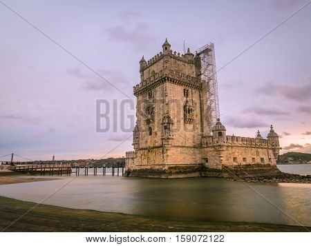 Torre de Belem on the bank of Tagus river in Lisbon Portugal at sunset.