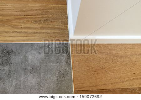 Joints Between Wood, Baseboards And Stone Floor
