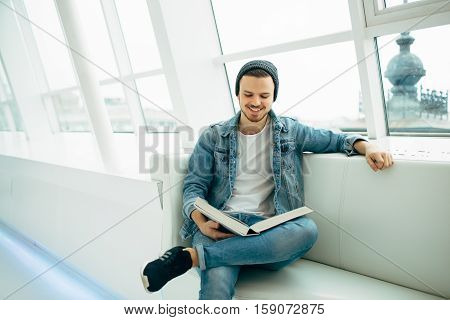 Successful Business Man Sitting In Cafe With Book