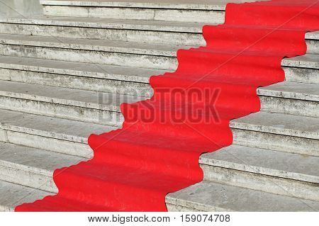 Long Red Carpet On The Steps Waiting For The Arrival Of Vips