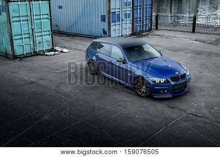 Moscow, Russia - October 02, 2016: Blue car BMW 3 Series E91 standing near containers