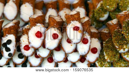 Typical Sicilian Pastries Called Cannoli With Cherries
