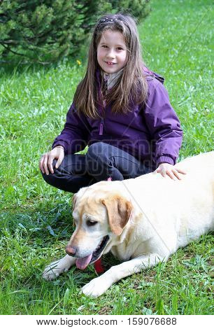 Caucasian Young Girl And Dog Lying On Meadow