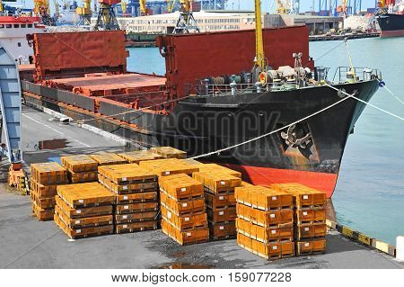 Bulk Cargo Ship And Rolled Metal Stack