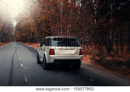 Moscow, Russia - October 23, 2016: Car Land Rover Range Rover Sport drive on asphalt road at autumn forest