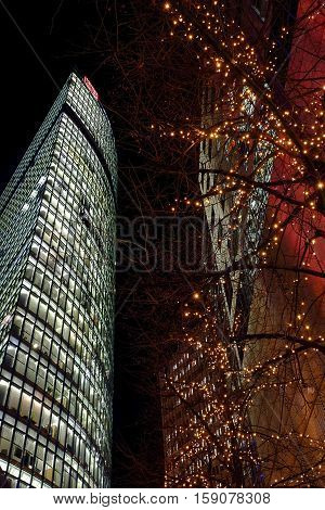 Office building in Sony Center and tree decorated with Christmas lights at night. Berlin Germany - 29.11.2016.