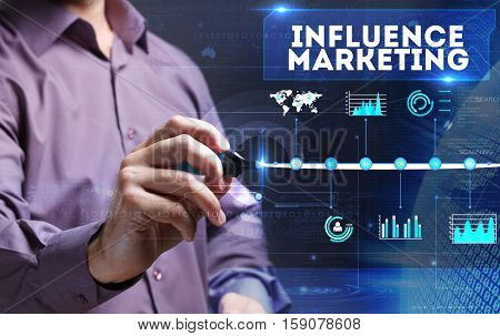 Technology, Internet, Business And Marketing. Young Business Man Writing Word: Influence Marketing
