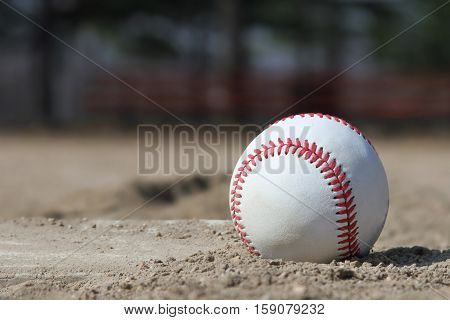 Photo of a baseball in the dirt next to the pitchers mound