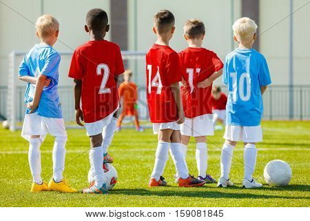 Children Football Training. Coaching Youth Soccer. Young Boys Training Football on Pitch