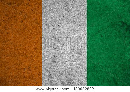 Cote D Ivoire Flag On An Old Grunge Background