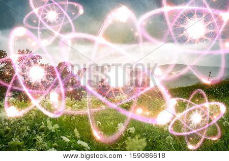 Magical landscape field with mountains and atomic particles
