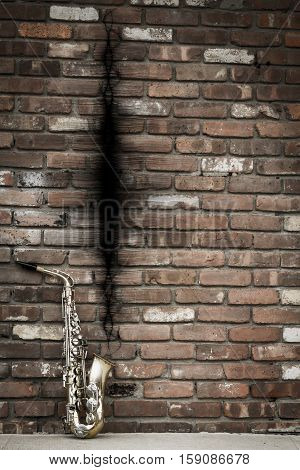 Jazz saxophone with sound wave on grungy street