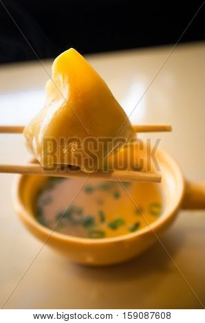 Authentic chinese food wonton soup with green onion