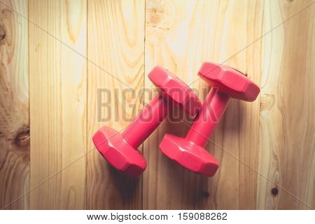 Pair Of Red 1 Kg Dumbbells On Wood , Vintage