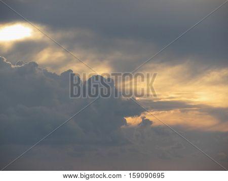 Warm sky with giants cumulonimbus clouds at sunset