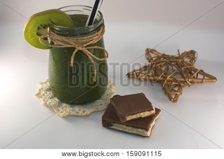 bronz star chocolate and green smoothie on a white background