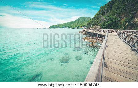 Wooden Bridge with beautiful seacape in koh lan Thailand vintage tone