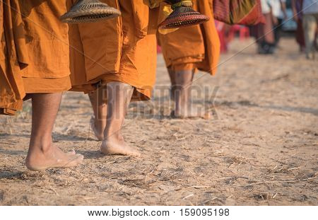 Feet of a Buddhist monk in the morning walk