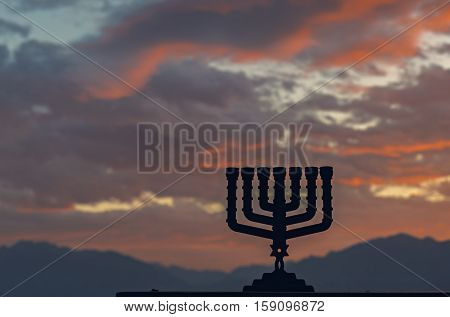 Traditional Jewish symbol for Hanukkah holiday. Selective focus. cloudscape and mountains as background