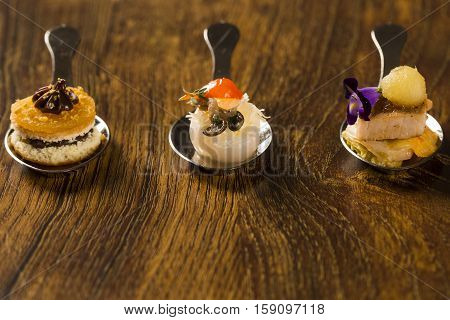 Entry, Entree And Dessert Of Finger Food In A Spoon. Taste Gastronomy Finger Food