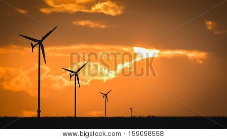 wind turbine sunset background ecosystem in Thailand.