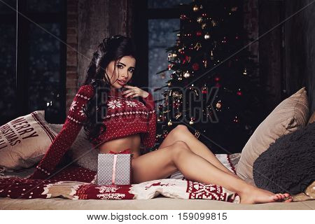 Cute Brunette Woman Fashion Model with Christmas Gift Box at Home. Winter Beauty