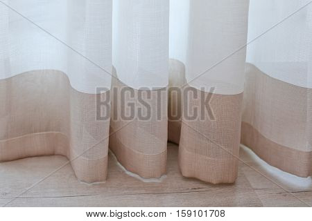 Room window with colorful striped curtains