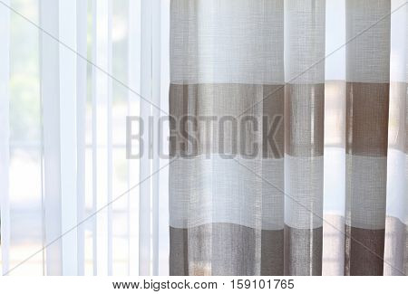 Room window with colorful striped curtains, close up
