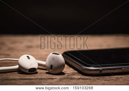 Headphone And Phone Media Portable On Dark Tone.