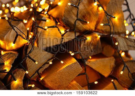 Stack of firewood and garland, close up view