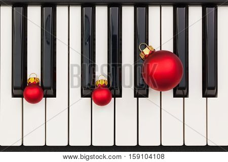 Top view close up shot of piano keyboard and Christmas decoration. Flat Lay Image