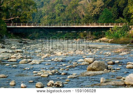 Bridge passing over a mountain river in a hill station in Jim Corbett park India
