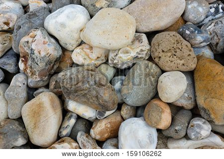 Multi-coloured stones and pebbles on a beach