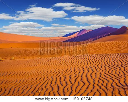 Travel to Namibia. The dunes and sandy orange waves. Namib-Naukluft National Park