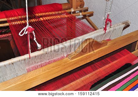 Weaving on a wooden loom,traditional  gainful employment