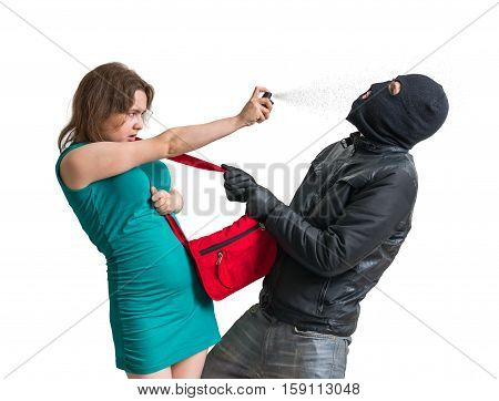 Self Defense Concept. Young Woman Is Defending With Pepper Spray