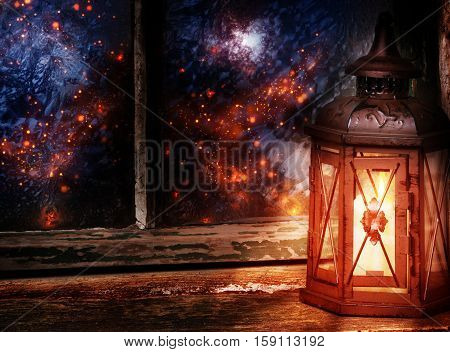 Old lantern stands in a chamber at wintery window