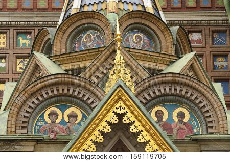 27.11.2016.Russia.Saint-Petersburg.Mosaic with Christian characters on the walls of the temple Savior on spilled Blood.