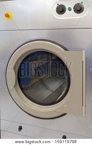 Front panel of the washing machine close-up. Industry