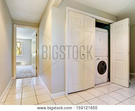 Hallway Interior With Built-in Laundry Appliances