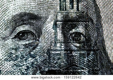 Fragment of a hundred dollar bill closeup in transmission. Selective focus