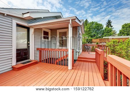 Backyard Of Craftsman Home With Red Deck