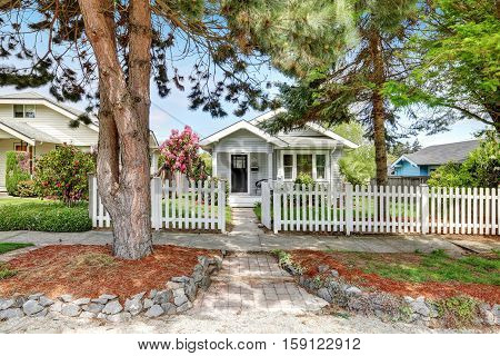 Cute Craftsman Home Exterior With Picket Fence