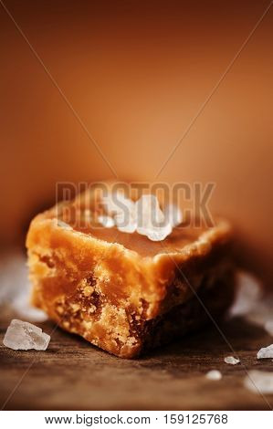 Caramel. Golden Butterscotch toffee candy caramels. Toffees with copy space macro.