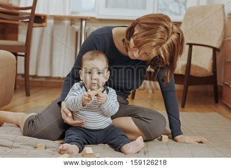 Cute Small Baby Boy Playing With Wooden Blocks