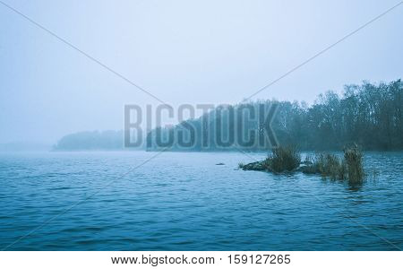Winter Scene Of A Cold Bleak Lake And Forests
