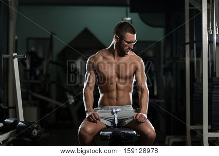 Nerd Man After Exercise Resting In Gym